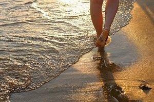 Feet walking near surf