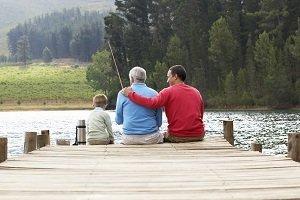 family fishing on dock