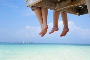 Feet dangling on dock